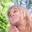 Beautiful slightly smiling little blond girl portrait — Stock Photo #11966986