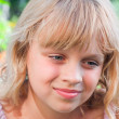 Beautiful slightly smiling little blond girl portrait — Stock Photo #11966989