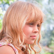 Beautiful slightly smiling little blond girl portrait — Stock Photo #11966991