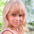 Beautiful slightly smiling little blond girl portrait — Stock Photo #11966993