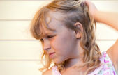 Profile portrait of a little blond beautiful girl — Stock Photo