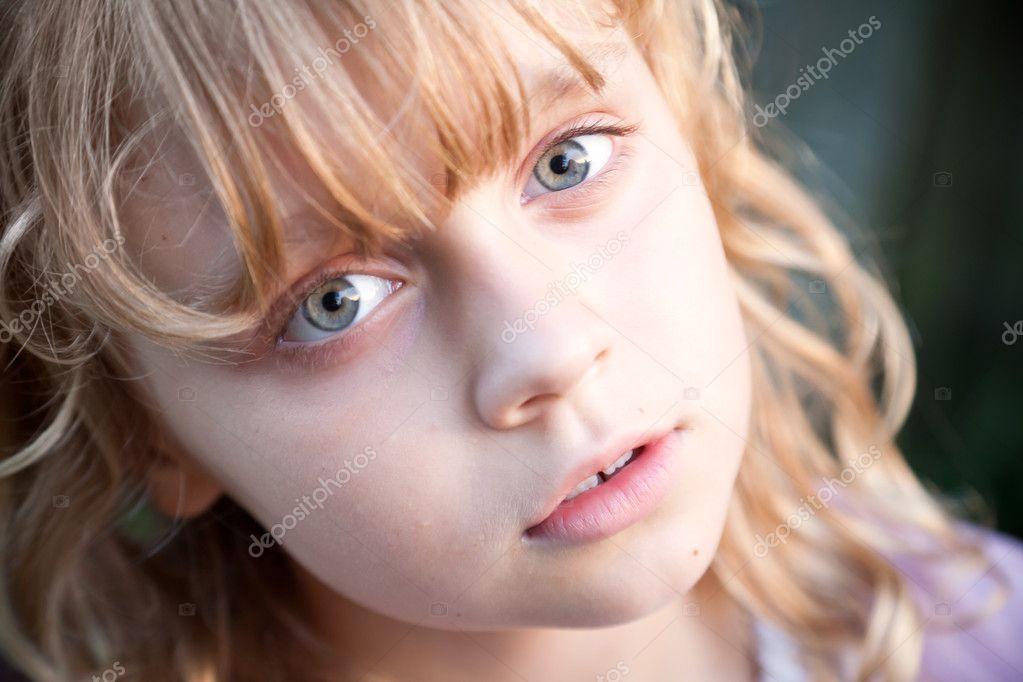 portrait of beautiful little blond russian girl stock