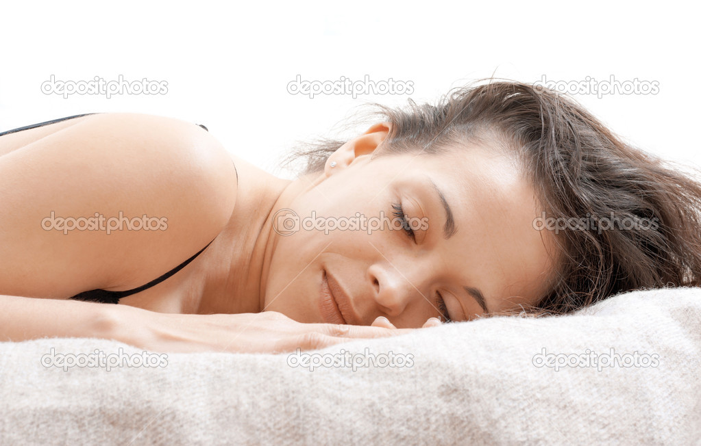 A woman lying on a bed with a rested face — Stock Photo #11137755