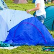 Putting up tent in a camping — Stock Photo #12249080