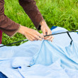 Putting up tent in a camping — Stock Photo #12249149
