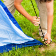 Putting up tent in a camping — Stock Photo