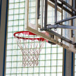 Stock Photo: Basketball hoop in gymnasium