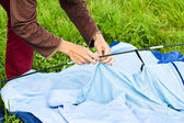 Putting up tent in a camping — Fotografia Stock