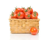 A basket of tomatoes on a white background — Stock Photo