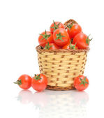 Wicker basket with ripe tomatoes — Stock Photo