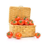 A basket of tomatoes on a white background — Stockfoto