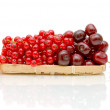 Ripe red currant and ripe cherry on a white background — Stock Photo