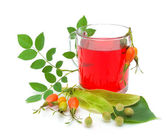 Tea from berries rose hips and linden seeds on a white backgroun — Stock Photo