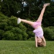 Little girl doing a cartwheel — Stock Photo
