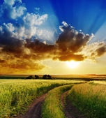 Dramatic sunset over rural road — Stock Photo
