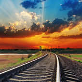 Red sunset over railway to horizon — Stock Photo