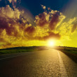 Stock Photo: Asphalt road to sunset
