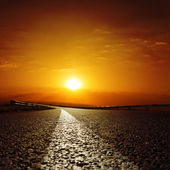 Asphalt road to red sunset — Stock Photo