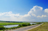 Two way: road and river — Stock Photo