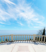 View to the sea from a balcony under cloudy sky — Stok fotoğraf
