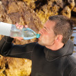 Stock Photo: Mdrink water slake quench one's thirst