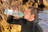 Man drink water slake quench one's thirst — Stock Photo
