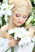 Portrait beauty make up of blonde young woman with white lily, n — Foto Stock