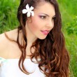 Young woman outdoors portrait. Beautiful face and long curly hea - Stock Photo