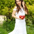 Stock Photo: Portrait of attractive young womwith apples, outdoors n
