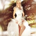 Elegant bride showing sexy leg — Stock Photo