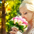 Bride with bouquet in the hands — Stock Photo