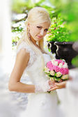 Bride holding bouquet in the hands — Stock Photo
