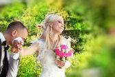 Groom kissing hand of female bride, outdoors portrait — Stock Photo