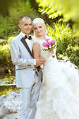 Bride and groom, outdoors portrait — Stock Photo