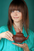 Tea ceremony with beautiful young woman on blue background — Stock Photo