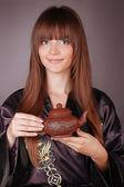 Tea ceremony happy woman with teapot on hands — Stock Photo