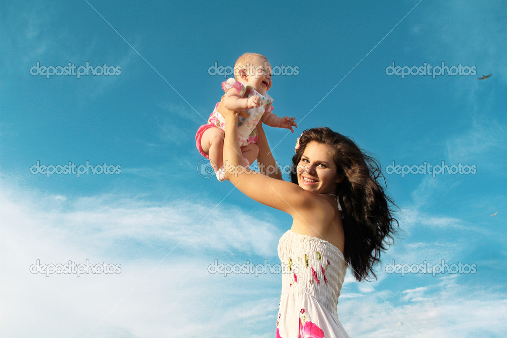 Happy mother playing with baby over blue sky — Stock Photo #11824733