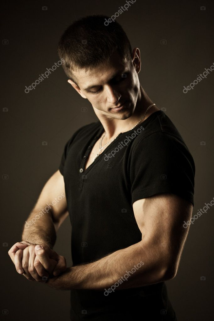 Portrait of young muscular man in studio — Stock Photo #11164806