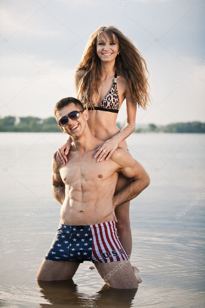 Attractive young heterosexual couple on beach  Stock Photo #11453585
