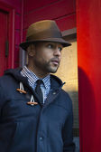 Young Black Man with Fedora in Red Doorway — Stock Photo