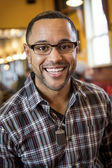 Portrait of Young Black Man in Coffee Shop — Stock Photo