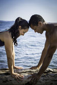 Beach Yoga with Young Couple - Vertical — Stock Photo