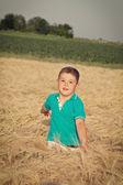 Happy boy in the field — Stock Photo