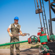 Oil worker check oil pump — Stock Photo #11417965