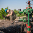 Oil worker check oil pump — Stock Photo