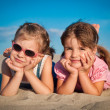 Two little girls on the sandy beach — Stock Photo