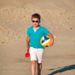 Adorable little boy playing on the sandy beach — Stock Photo