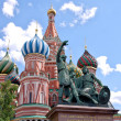 Royalty-Free Stock Photo: Monument to Minin and Pozharsky and St. Basil's Cathedral on the background of blue sky. Red Square. The Kremlin, Moscow