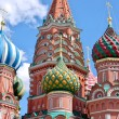 Domes of St. Basil's Cathedral in the background of the blue summer sky. Red Square, Moscow, Russia — Stock Photo