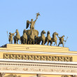 Stock Photo: The sculpture of horses on the triumphal arch